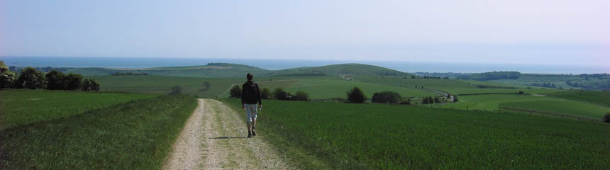Man walking along a footpath in the countryside